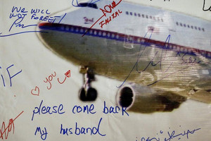 Messages left on a board of remembrance by friends and family of passengers aboard missing flight MH370 (Reuters / file)