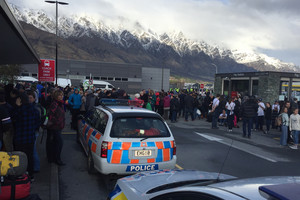 People congregate outside Queenstown Airport after the terminal is evacuated (Jeff Aldridge / Newshub.)