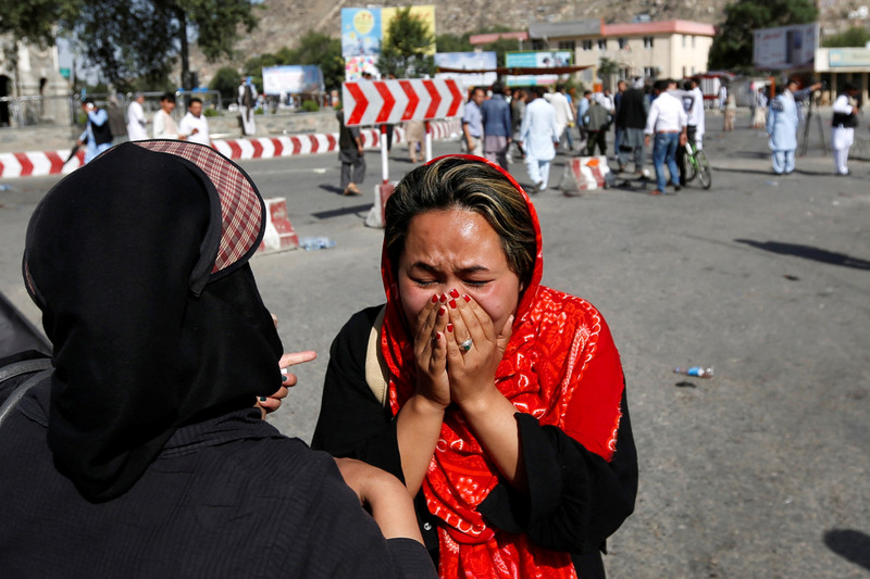 An Afghan woman weeps at site of a suicide attack in Kabul, Afghanistan (Reuters)