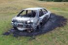 Car set alight, abandoned on Dunedin golf course