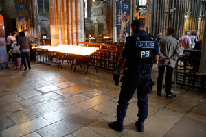 A French policeman stands guard as people attend a mass to pay tribute to French priest Father Jacques Hamel (Reuters)