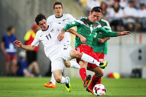 All White Marco Rojas competes for the ball with Mexico's Miguel Layun (Photosport)