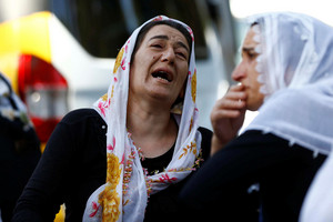 Women mourn as they wait in front of a hospital morgue in the Turkish city of Gaziantep (Reuters)