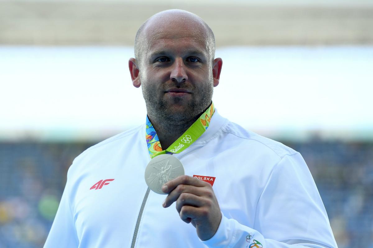 Polish Olympian Piotr Malachowski auctions silver medal for boy with rare cancer
