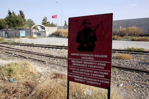 The Turkish army began firing artillery rounds into the Syrian border town of Jarablus on Wednesday (Reuters)
