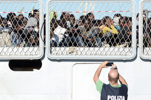 Migrants wait to disembark from the Italian Navy ship Borsini in the Sicilian harbour of Palermo (Reuters)