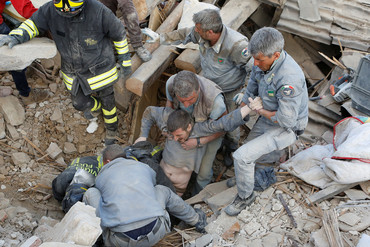 A man is rescued alive from the ruins following an earthquake in Amatrice (Reuters)