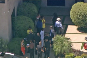 Police at Chris Brown's house after alleged gun threat