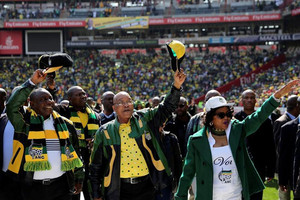 African National Congress (ANC) president Jacob Zuma (C) waves to his supporters next to his deputy, Cyril Ramaphosa (L) (Reuters)