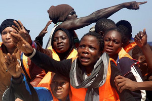 African migrants on an overcrowded dinghy during a rescue operation (Reuters)