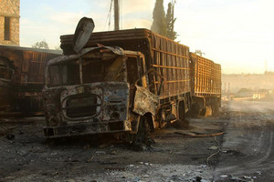18 trucks were destroyed in the airstrike (Reuters)