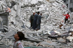 People inspect a damaged site after airstrikes on Aleppo, Syria, September 23 (Reuters)