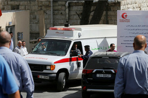 An ambulance takes the body of Nahed Hattar to a medical facility (Reuters)