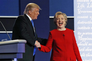 Donald Trump and Hillary Clinton shake hands at the first presidential debate (Reuters)