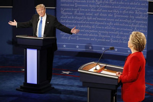 Republican US presidential nominee Donald Trump speaks as Democratic U.S. presidential nominee Hillary Clinton listens during their first presidential debate (Reuters)