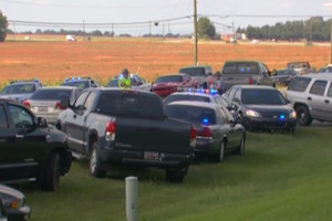 Television images showed police swarming the school (CBS News)