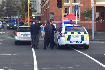 A police car partially blocks off Quay St in downtown Auckland (Billy Paine / Newshub.)