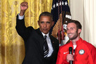 Obama honours Olympians behind iconic salute