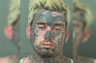 Heavily tattooed Florida man arrested while sleeping in stolen truck