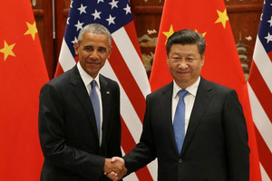US President Barack Obama and Chinese President Xi Jinping shake hands during their meeting ahead of the G20 Summiit (Reuters)